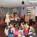Children interacting with Betty and her balloon story of the three little pigs